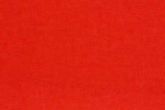 被回收的工艺纸构造了在浅红色老背景上升了c 库存图片