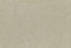 被回收的纸纹理样式背景,水平的苍白灰色米黄Tan灰褐色织地不很细宏观特写镜头粗砺灰色自然手工制造 库存照片