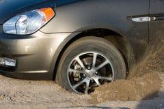 被困住的汽车沙子 免版税图库摄影