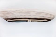 被困住的汽车随风飘飞的雪 免版税库存图片