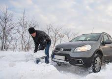 被困住的汽车雪 免版税库存照片