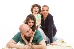 被堆的愉快的家庭 免版税库存图片