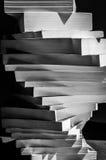 被堆积的书漩涡在黑白的 免版税库存照片