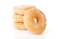 被堆积的可口加糖的油炸圈饼 免版税库存照片