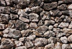 被堆积的石头背景纹理 免版税库存照片