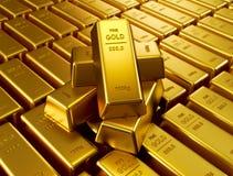 被堆积的金黄棒 免版税库存照片
