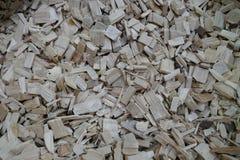 被处理的木头到片断里作为纹理 免版税库存照片