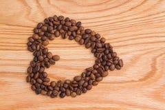 被安排的豆咖啡重点形状 库存图片