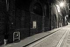被定调子的空的老街道乌贼属 库存照片