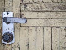 被射击的接近的门把手 免版税库存图片