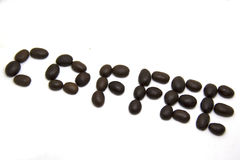 被射击的豆接近的咖啡 图库摄影