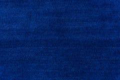 被布置的沙发和家的蓝色背景织品 库存照片