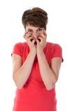被干扰的妇女用面孔的手 免版税库存图片