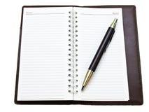 被开张的口袋笔记本和ballpen 库存图片