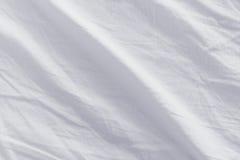 被弄皱的床单纹理 免版税库存照片
