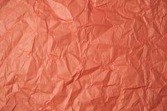 被弄皱的橙色纸纹理 免版税图库摄影