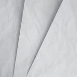 被弄皱的白皮书分层堆积背景 库存照片