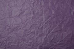 被弄皱的紫色纸纹理 免版税库存图片