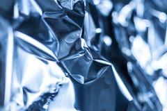 被弄皱的蓝色铝芯板料的充分的框架作为  免版税库存照片