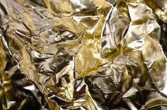 被弄皱的金黄箔 免版税库存照片