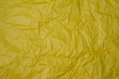 被弄皱的黄色纸纹理 免版税库存照片