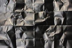 被弄皱的黑纸空白  您的后面的黑纸纹理 免版税库存照片