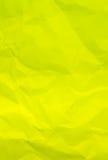 被弄皱的黄色纸背景 免版税库存照片