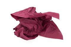被弄皱的紫色餐巾 库存照片