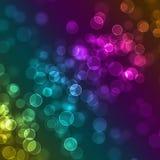 被弄脏的五颜六色的闪闪发光defocused背景 库存图片