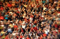 被弄脏的人群观众体育场论坛 免版税图库摄影