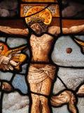 被弄脏的在十字架上钉死玻璃中世纪 库存照片