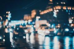 被弄脏的城市在晚上 Bokeh 图库摄影