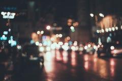 被弄脏的城市在晚上 Bokeh 免版税库存图片