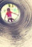 被弄脏的女孩在隧道的末端 库存图片