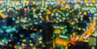 被弄脏的抽象背景点燃,曼谷市美好的顶视图  免版税库存照片
