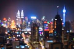 被弄脏的抽象背景点燃,美好的都市风景视图  免版税图库摄影