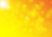 被弄脏的背景橙黄的Boke 免版税库存图片