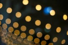 被弄脏的背景,从电灯泡的明亮的bokeh 库存照片