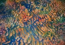 被弄脏的蓝色黄绿色橙色黑暗的油漆颜色 抽象油漆水彩背景 免版税库存图片