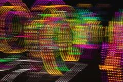 被弄脏的虚线抽象背景在黑暗的背景的 免版税库存照片