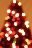 被弄脏的被点燃的圣诞树 库存图片