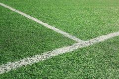 被弄脏的足球场细节背景 免版税库存图片