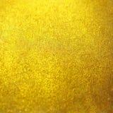 被弄脏的金金黄金属闪烁表面背景纹理 免版税库存照片