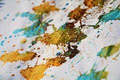 被弄脏的金黄红色蓝色斑点构造,给冬天背景打蜡 免版税库存照片