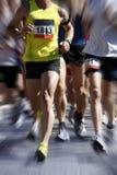 被弄脏的马拉松行动赛跑者 图库摄影