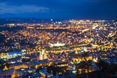 被弄脏的Bokeh建筑都市背景 与都市的背景 免版税库存图片