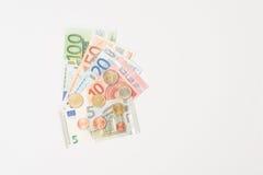 被扇动的欧洲纸币和硬币 库存照片