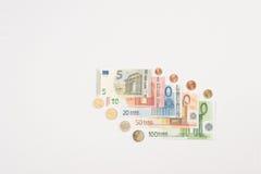 被扇动的欧洲纸币和硬币 库存图片