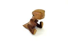 被手工造的风俗充塞了皮革玩具小恐龙-坐 免版税库存图片