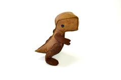 被手工造的风俗充塞了皮革玩具小恐龙-坐 免版税库存照片
